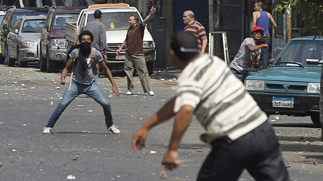 local-resident-throws-stones-towards-supporters-of-ousted-president-mohamed-mursi-during-clashes-in-central-cairo